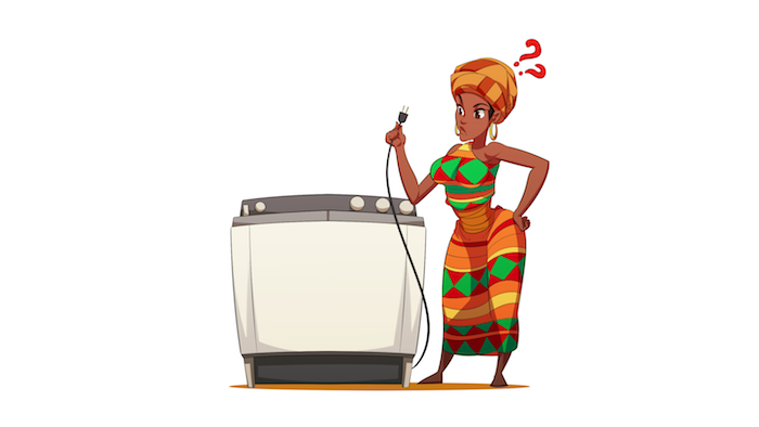 A woman from Africa looking confused holding the power cord of a washing machine.
